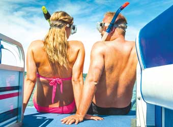 Couple on a Blue Sky Rental Boat with snorkles